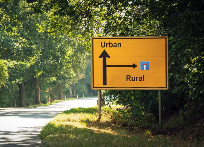 urban vs rural road sign