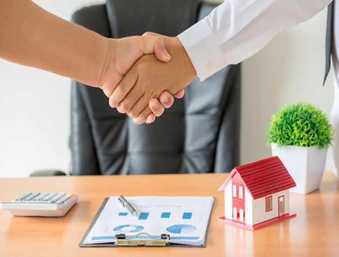 shaking hands over house contract